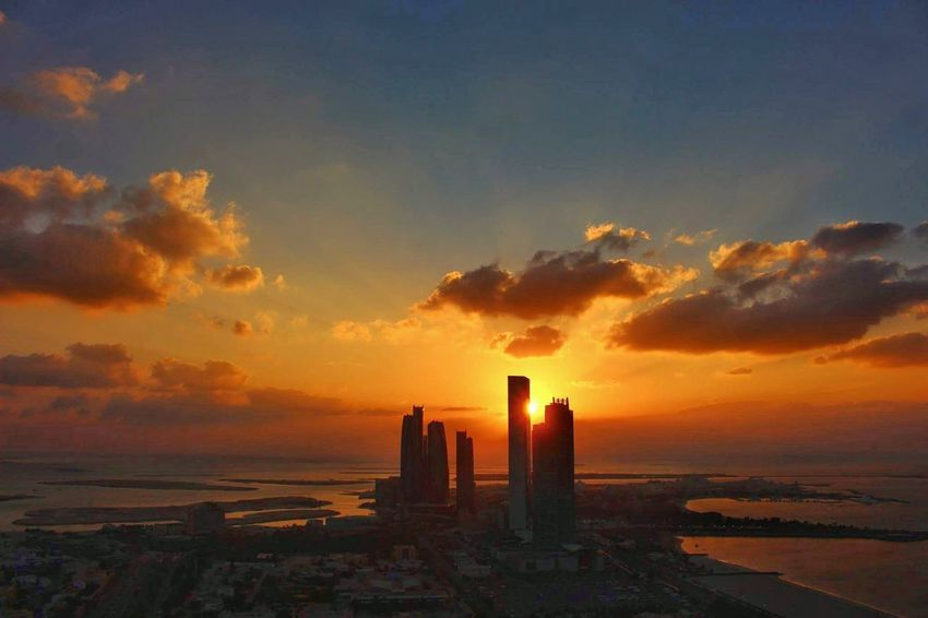 Sunset No People Travel Destinations Sea Modern Cloud - Sky Outdoors Cityscape Architecture Sky Day Vacations Technology Modern Street Photography Architecture Lifestyles SubahanaALLAH Adapted To The City Miles Away
