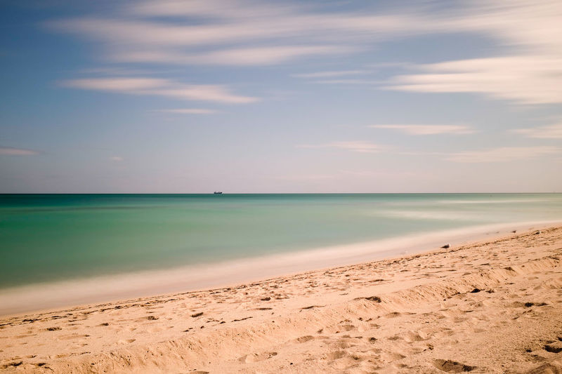 Long exposure of sea and sand at Miami Beach Beach Beauty In Nature Cloud - Sky Day Horizon Over Water Long Exposure Nature No People Ocean Outdoors Sand Sand And Sea Sandy Scenics Sea Sea And Sky Seascape Sky Tranquil Scene Tranquility Water