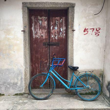 Bicycle at Dapeng Ancient Village - Shenzhen, China Bicycle Bicycling Cycle Wheel Bicycle Wheel Dapeng China Chinese Shenzhen Dapeng Ancient Village Door Wall Old Bike Old Bicycle Ancient Village Retro Old Style Village Chinese Village Rusty Bicycle Wheels