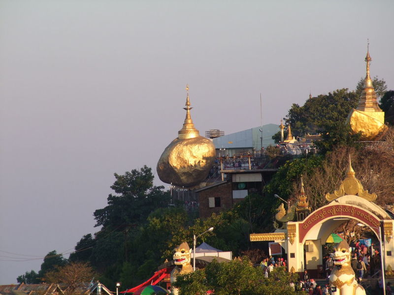 Early Morning Sun on Mount Kyaiktiyo (Golden Rock) Pagoda Buddhism Buddhist Culture Composition Early Morning Sunlight Gold Coloured Golden Rock Golden Rock Pagoda Hazy Sky Kinpun Mount Kyaiktiyo Mount Kyaiktiyo Pagoda Myanmar No People Outdoor Photography Pagoda Place Of Pilgrimage Place Of Prayer Place Of Worship Place Of Worship Religion Tourism Tourist Attraction  Travel Travel Destination Tree