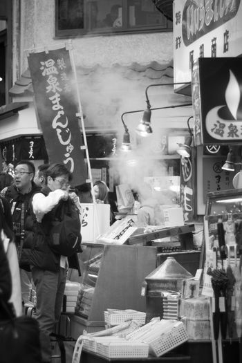 温泉まんじゅう♨ Streetphotography Blackandwhite Japan Japan Photography Olympus Olympus Om-d E-m10 EyeEm Monochrome Black&white Takumar Oldlens City Men Street Market Street Food Market Bazaar For Sale Display Shop