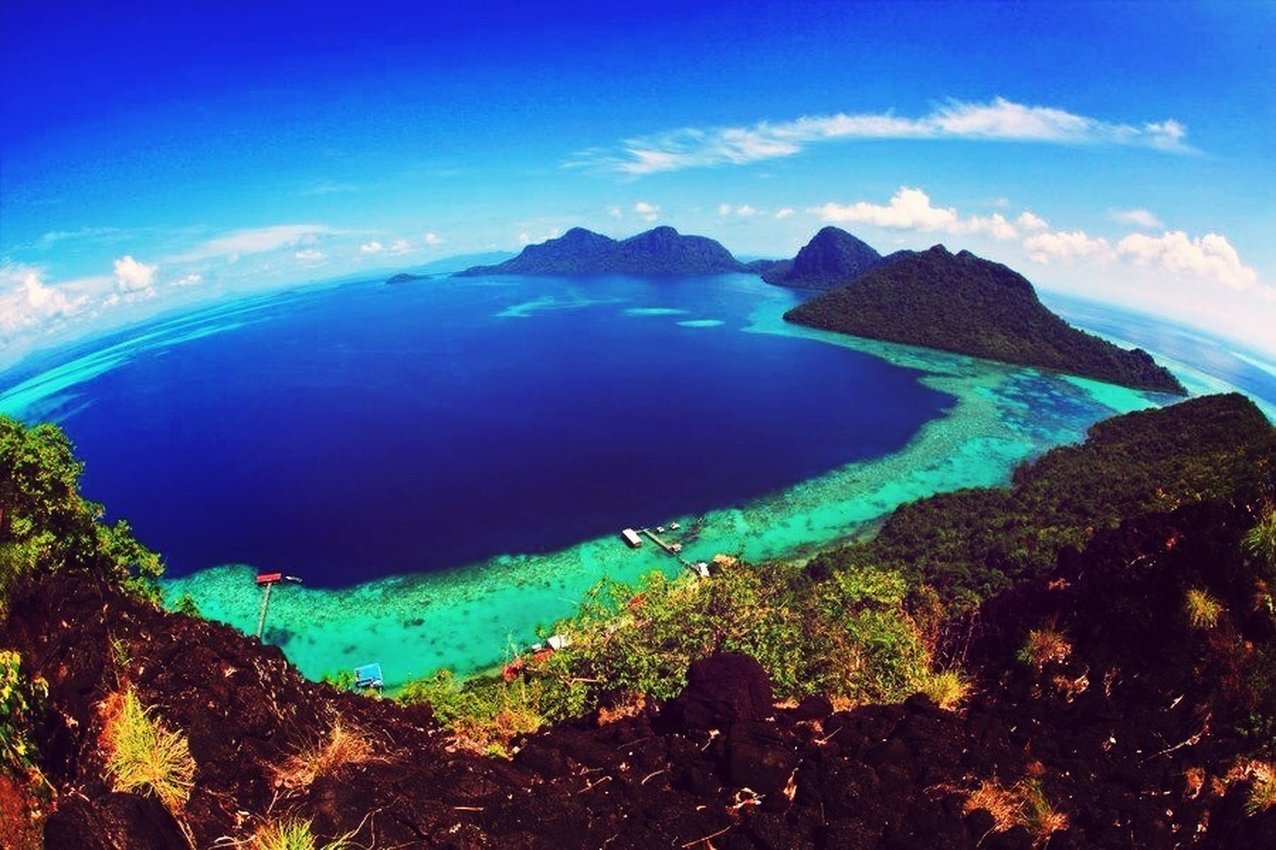 sea, water, blue, scenics, tranquil scene, sky, tranquility, beauty in nature, nature, horizon over water, idyllic, mountain, cloud - sky, cloud, non-urban scene, coastline, sunlight, rock formation, landscape, rock - object