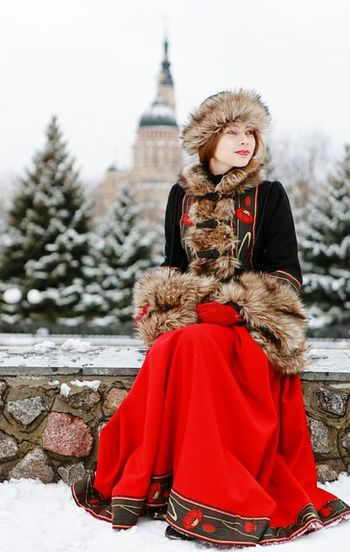 Winter Warm Clothing Cold Temperature Snow One Woman Only Adults Only Fur Red Coat Only Women One Person People Adult Young Adult Snowing Outdoors Day