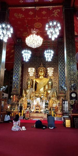 Statue of illuminated building in temple