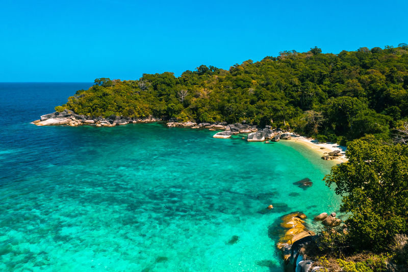 Aerial View of the beach in Boulder Island, Myanmar Nga Khin Nyo Island Boulder Island Myanmar Areal View Top View Travel Andaman Tranquility Outdoors Day Beach Turquoise Colored Clear Sky Nature Tranquil Scene Blue Sky Land Plant Beauty In Nature Scenics - Nature Tree Sea Water Aerial View