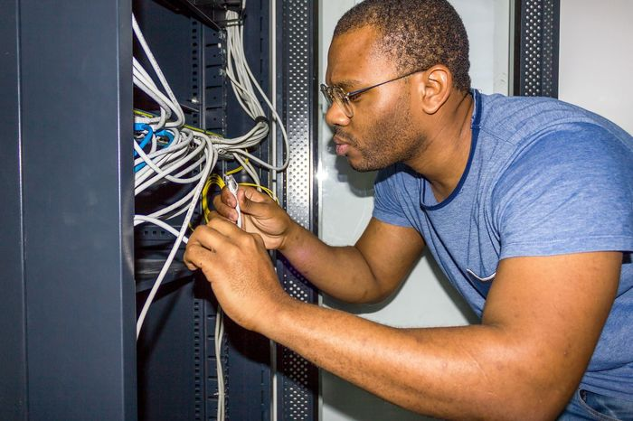 IT Guy working Angola IT IT Support Luanda Room Switch Working Adult Africa Cable Computer Cable Computer Equipment It Professional IT Support Men Network Server Networking Occupation One Person Professional Occupation Racks Server Room Technician Technology Telecommunication