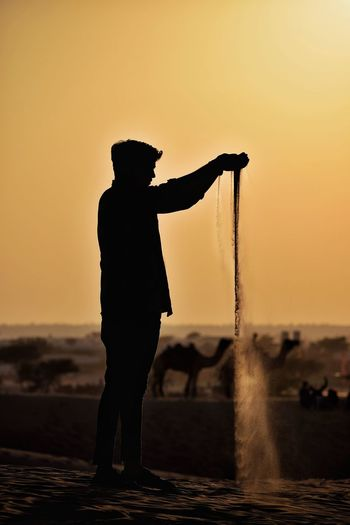 Flow of sand Manual Worker Salt - Mineral Sunset Men Beach Standing Full Length Sea Desert Camel Sand Dune Rajasthan Egyptian Culture Capture Tomorrow EyeEmNewHere