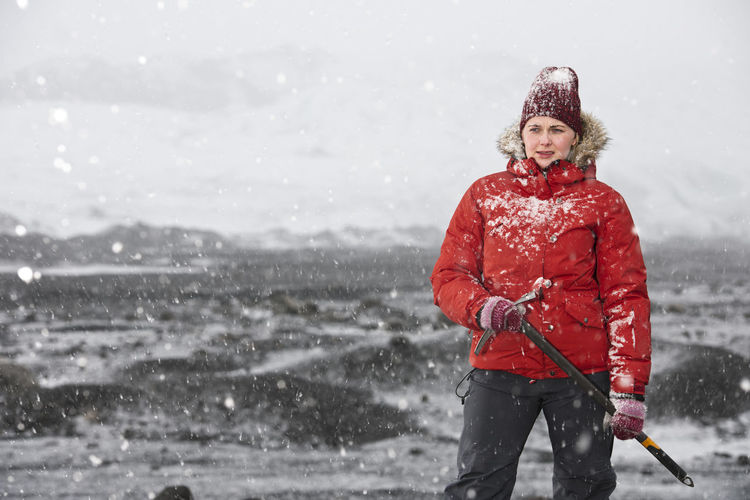 Portrait of woman standing on snow