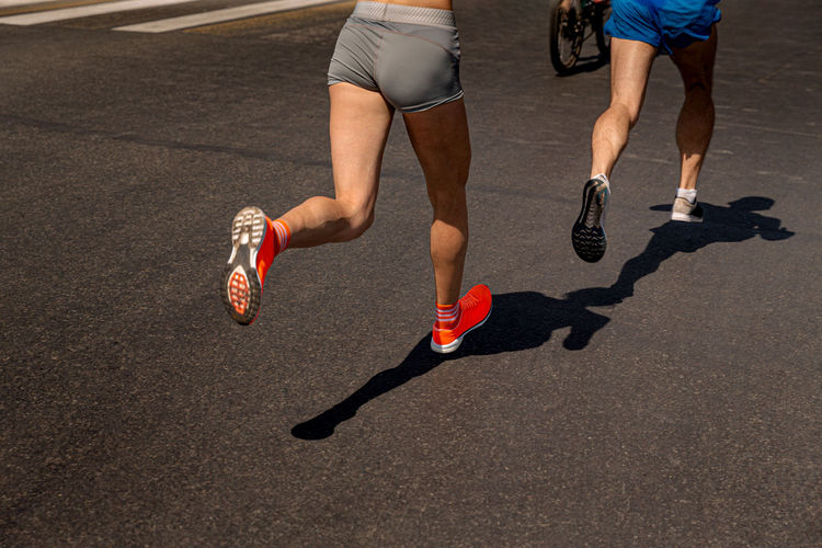 Low section of men running