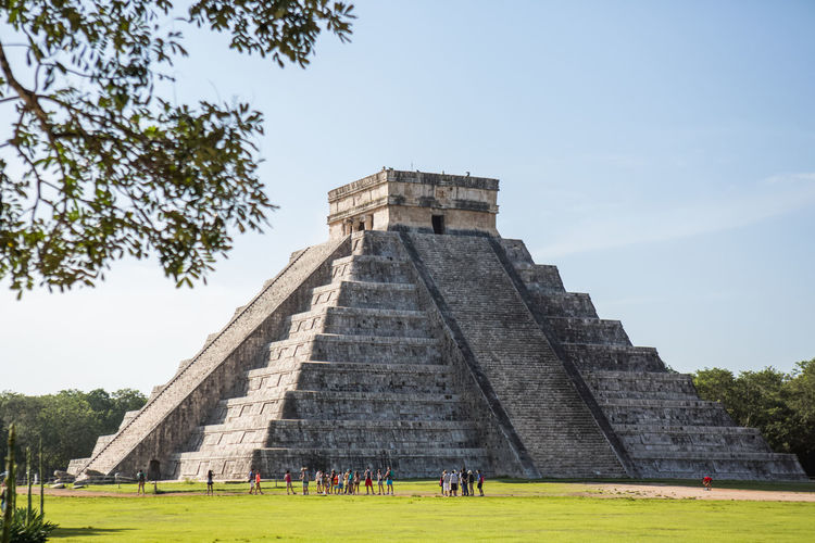 People By Chichen Itza Against Sky