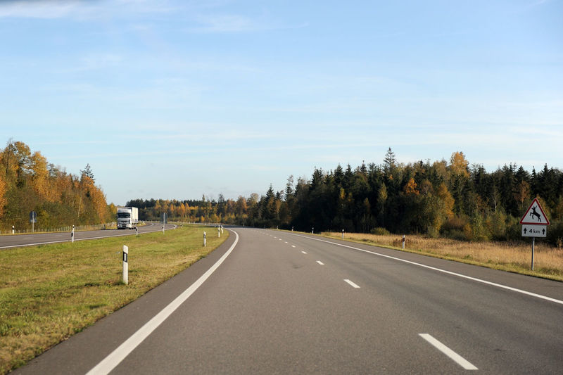 Lithuania Country Country Road Day Diminishing Perspective Direction Dividing Line Land Landscape Marking Nature No People Outdoors Panevėžys Plant Road Road Marking Scenics - Nature Sign Sky Symbol The Way Forward Tranquility Transportation Tree