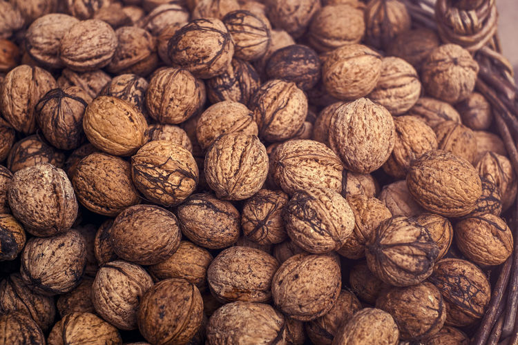 walnuts in wicker basket Abundance Backgrounds Brown Close-up Day Food Food And Drink Freshness Full Frame Healthy Eating Indoors  Large Group Of Objects No People Nut - Food Nutshell Still Life Walnut