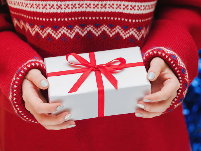 Midsection of woman holding gift box during christmas