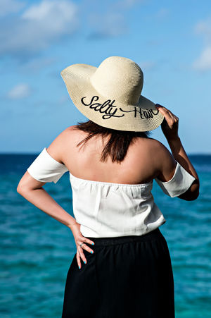 Salty Hair Beach Beach Hat Beautiful Woman Beauty Blue Sky And Sea Day Fashion Hat Human Body Part Lifestyles One Person One Woman Only Only Women Outdoors People Salty Hair  Sea Sky Standing Straw Hat Summer Summer Vibes Vacations Water Women