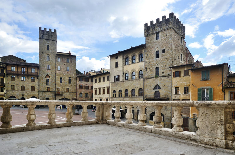 scenic view of ancient square, Piazza Grande, in Arezzo town, Tuscany, Italy Architecture The Past Cloud - Sky Travel Destinations Tourism Outdoors Railing No People Old History Window Building Exterior Square Tower Medieval Ancient Arezzo Cityscape Historic Center Travel Destination EyeEmNewHere EyeEm Best Edits