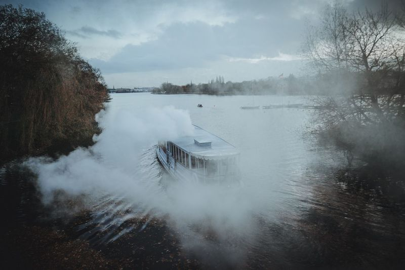 Steam ship on ricer Nostalgic  Live Authentic Tourist Activity Day Trip Alster Ships Hamburg Water Nature Beauty In Nature Sky Tree Winter Tranquility Outdoors Tranquil Scene Scenics Cloud - Sky No People Day Lake Cold Temperature