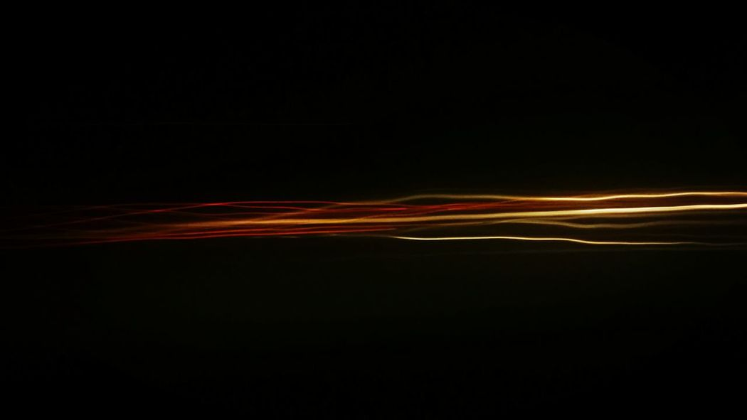 streetart 😉 ...taken from the backseat of the bus. Black Background Abstract Motion Lightpainting My Point Of View On The Road Night Glitchphotography Longexposurephotography Through The Night With ... Yellow Light On The Backseat Of The Bus Orange Color Scenics