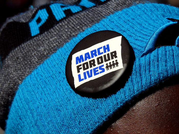 A button on a hat at the pro- gun control March For Our Lives in Washington, DC on March 24, 2018. Protest Activism Blue Citizenship Close-up Day Gun Control Gun Safety Indoors  March For Our Lives Mass Shooting No People Patriotism Politics Politics And Government Text Textile