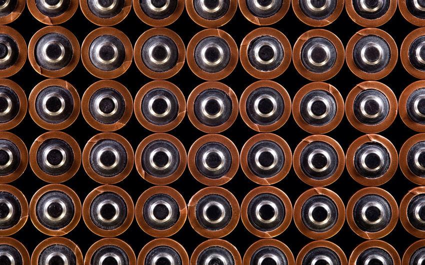Full frame shot of cans on black background