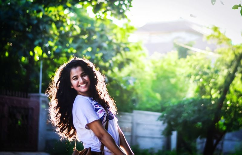 EyeEm Selects Happiness People Curly Hair Portrait Women Looking At Camera Long Hair Smiling Beauty Outdoors Beautiful Woman Casual Clothing Close-up Nature Sunlight Beauty In Nature Beautiful People Happiness Joy
