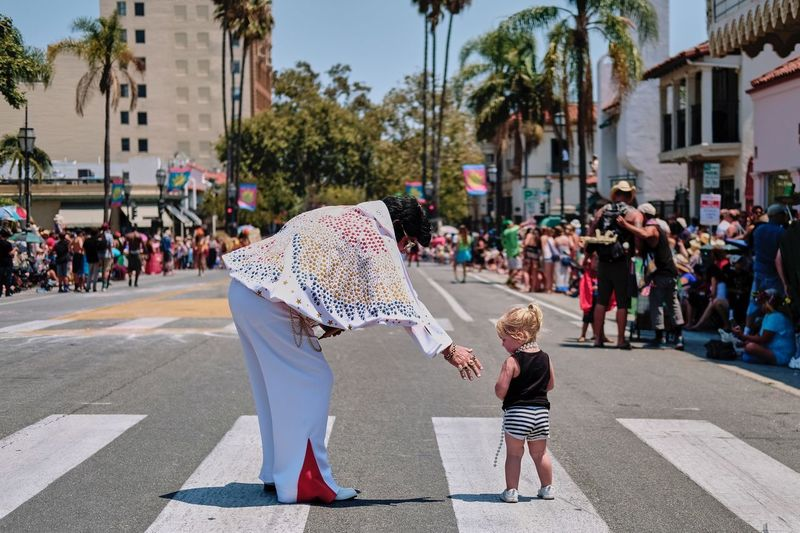The Princess and the King Little Girl Elvis Impersonation Elvis Presley Large Group Of People City Real People Day Building Exterior Leisure Activity Built Structure This Is Masculinity EyeEmNewHere