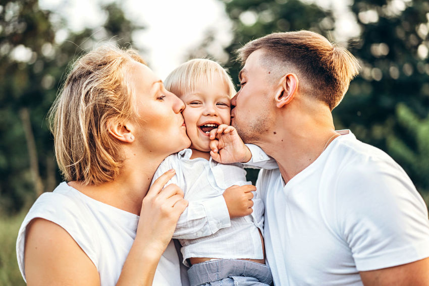 Happy family have fun outdoor Family Mother Father Childhood Son Family Love  Family Values Family Time Outdoors Plant Nature Having Fun Playing Togetherness REAL EMOTIONS Positive Emotion Candid Photography Lifestyles Smiling Happiness Kisses