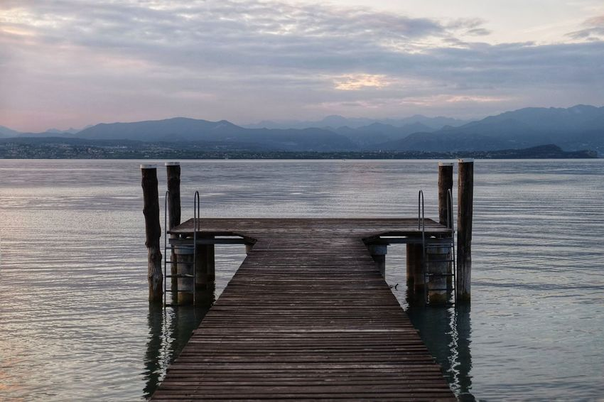 Water Mountain Pier Scenics Tranquility Tranquil Scene Wood - Material Mountain Range Nature Lake Jetty Beauty In Nature Sunset No People Sky Outdoors Day Wood Paneling FUJIFILM X-T10 XF18-55mmF2.8-4 R LM OIS F/3.6 Iso 200 via Fotofall