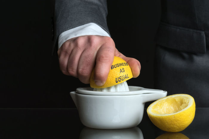 Business Business As Usual Businessman Citrus  Citrus Fruit Citrus Press Close-up Hand Holding Human Body Part Human Hand Indoors  Lemon Man Men One Man Only One Person People Pressure Push Real People Strain Usual Yellow
