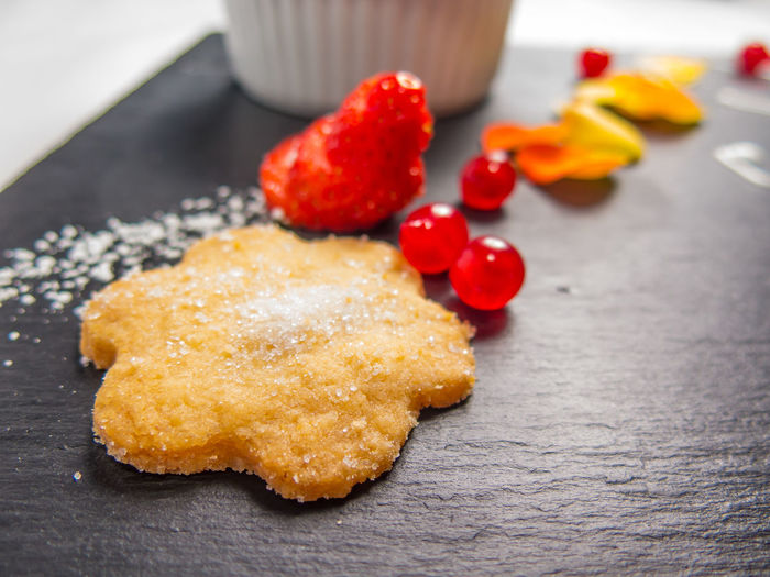 Close-Up Of Star Shape Cookie With Fruits Served On Plate