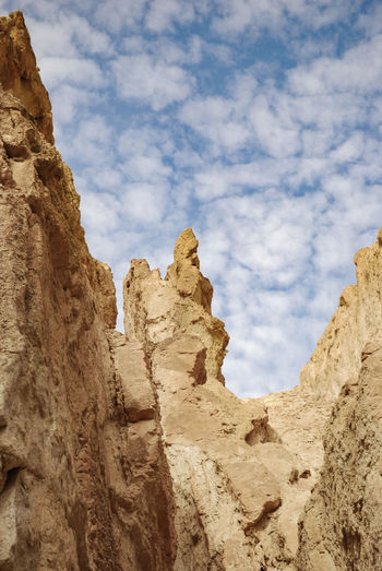 Tunis Cloud - Sky Rock Sky Rock Formation Rock - Object Solid Nature Low Angle View Scenics - Nature Beauty In Nature Day Mountain Tranquility Tranquil Scene No People Non-urban Scene Physical Geography Land Outdoors Geology Formation Arid Climate Climate Eroded Rosafrancomendoza