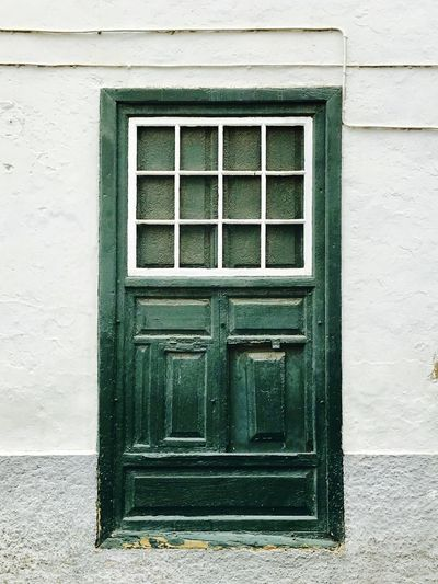 Framed Green Green Color Architecture Building Exterior Built Structure Close-up Closed Day Door Entre Frames Full Frame Green Door House No People Outdoors Pattern Small Windows Window Wooden Wooden Architecture Wooden Art Wooden Art Craft Wooden Texture