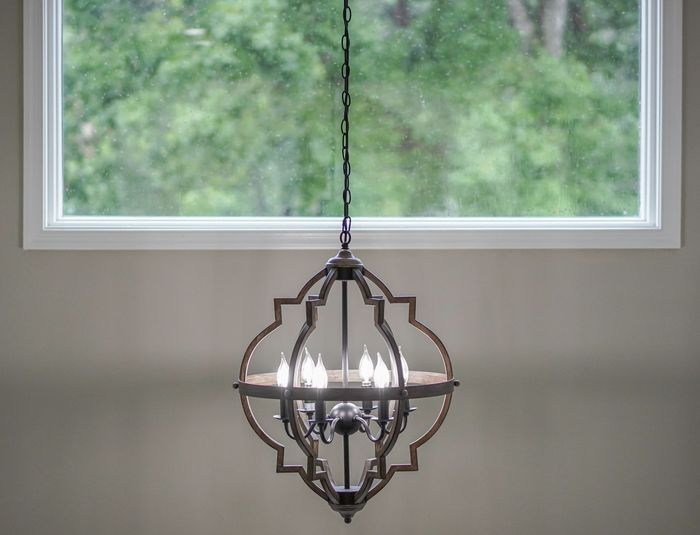 Close-up of electric lamp hanging at home