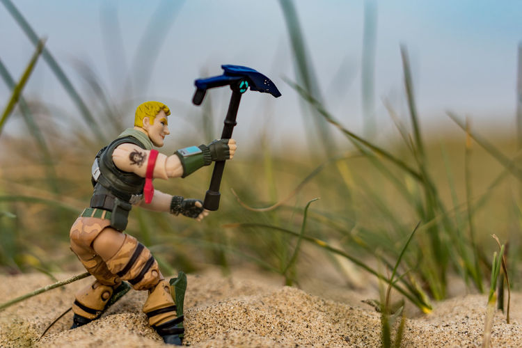 Fortnite toys at the beach. Toy Toys Fortnite Beach Sand Childhood Children Toyphotography Playing Playful Theme Toy Theme Computer Game Gaming Hobby Sport Figure Toy Figure Toy Figures Weapon Weapons Toy Pose Pose Childhooddays Play Day