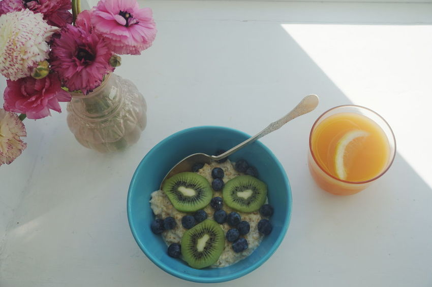 Perfect morning with sunshine, Oatmeal, juice and flowers Bowl Breakfast Day Flower Flower Head Flowers Food Food And Drink Fresh Fruits Freshness Granola Healthy Eating High Angle View Indoors  Juice Morning Morning Light No People Outmeal Overhead View Porridge Spoon Topdown Visual Feast