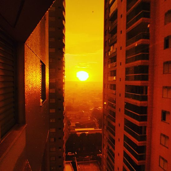 Sunset Built Structure Orange Color Architecture Building Exterior Sky Yellow No People City Cityscape Outdoors Skyscraper Day Welcome To Black City Life Illuminated GalaxyS7Edge EyeEmNewHere The City Light Architecture City Colorsofbrazil Backgrounds The Secret Spaces Paint The Town Yellow Been There.