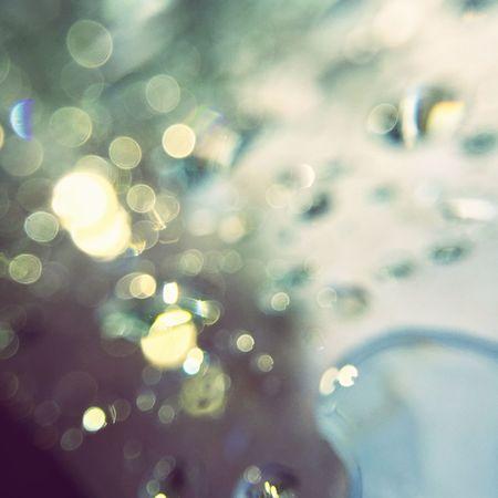 Capture Motion running water drops on the glass makes beautiful Bohkeh Maximum Closeness