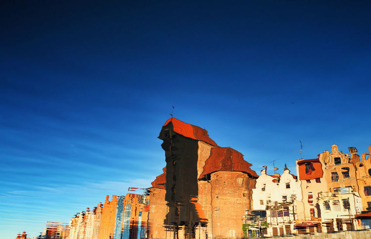Old Crane mirrored in Motlawa river in Gdańsk Brick Wall Gdansk (Danzig) Holiday Mirrored Old Town Postcard Tourist Attraction  Blue Building Exterior Buildings Crane Destination Europe Gdansk Historic History Landscape Motława River Tourism Wallpaper Water Lost In The Landscape