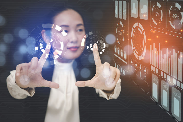 Digital composite image of woman holding camera