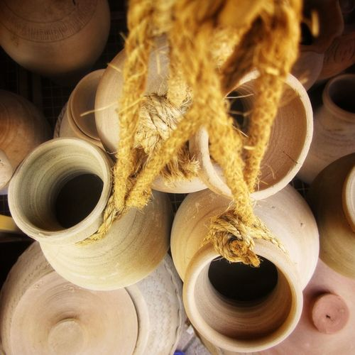 Pottery for sale as souvenirs in Nizwa Souq, Oman. Market Oman Art Art And Craft Clay Close-up Container Craft Day Earthenware Focus On Foreground Food And Drink High Angle View Jar Jug Large Group Of Objects Nizwa Souq Pot Pottery Pottery Art Soup Souvenir Vessel