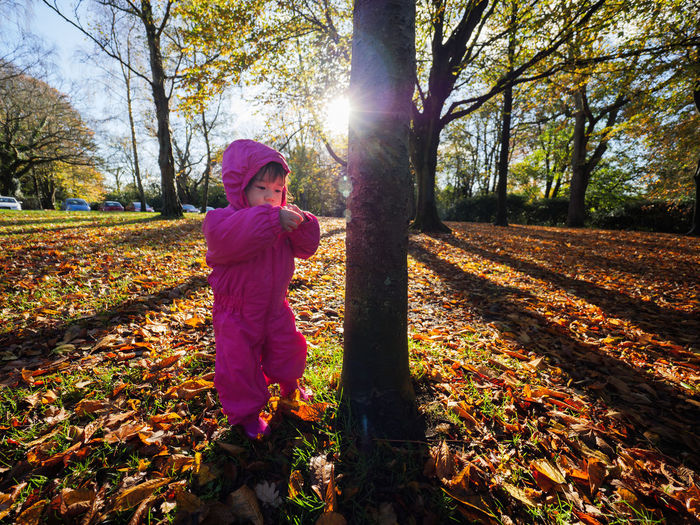 Girl standing on field during autumn