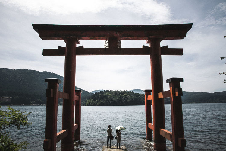 Lake Ash in Hakone Lake Ashi Shinto Shrine Architecture Beauty In Nature Cloud - Sky Day Hakone Lake Leisure Activity Men Mountain Nature Outdoors People Real People Scenics Sky Standing Two People Water