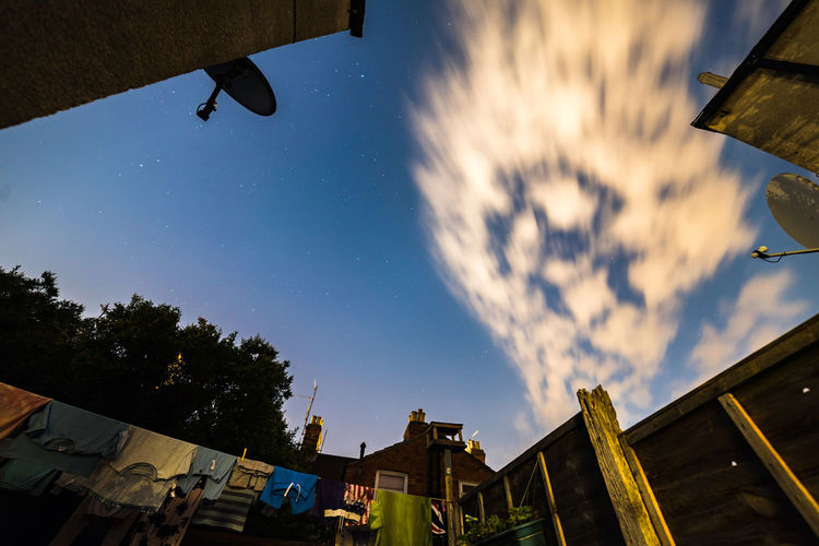 Wide angle view of night sky from British ghetto garden HUAWEI Photo Award: After Dark Architecture Building Building Exterior Built Structure City Cloud - Sky Day Flying House Low Angle View Mid-air Motion Nature No People Outdoors Plant Reflection Residential District Sky Tree Capture Tomorrow