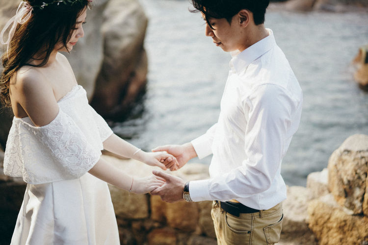 Bonding Bride Couple - Relationship Day Happiness Holding Hands Life Events Love Love ♥ Outdoors Real People Sunset Togetherness Two People Wedding Wedding Dress