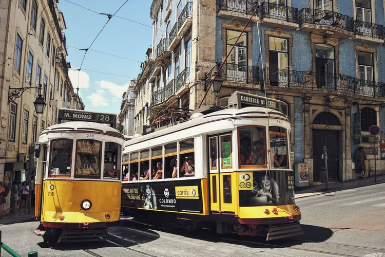 Tram Architecture Building Exterior Built Structure City Day Land Vehicle Lisbon Mode Of Transport Outdoors Public Transportation Real People Road Sky Street Trams Transportation Yellow