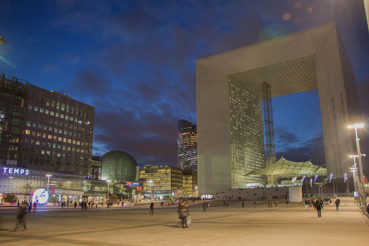Business Stories La Défense Night Lights Paris Sky And Clouds Arches Architecture Building Exterior Built Structure City Illuminated Lifestyles Modern Night Night Fall Outdoors Sky