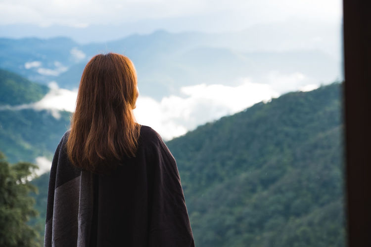 A woman standing alone and looking at mountains on foggy day with blue sky background in the morning Standing Space Sky Scenic Scenery Relax People Outdoor Nature Natural Mountains Mountain Looking Lonely Lifestyle Leisure Landscape Journey Inspiration Hill Happiness Green Girl Freedom Forest Foggy Female Explorer Environment Discovery Copyspace Copy Beautiful Backpacker Background ASIA Alone Adventure Adult