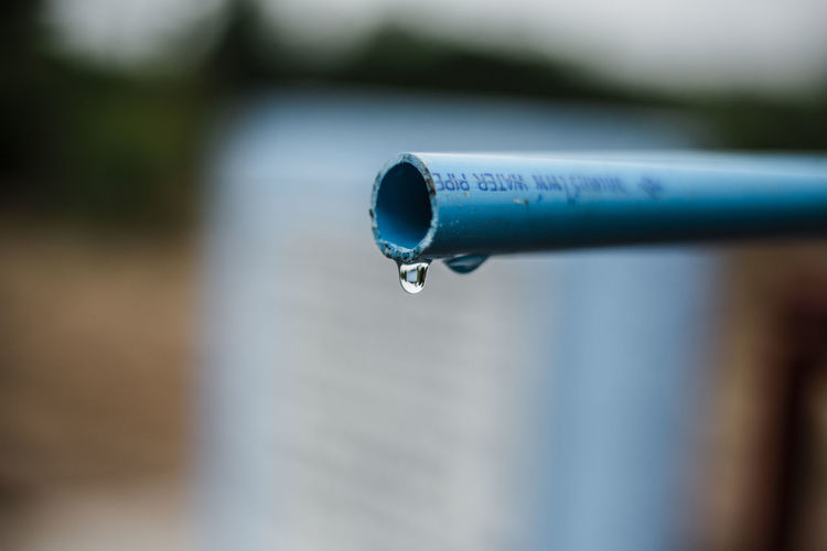 Drop Selective Focus Water Close-up Blue Focus On Foreground Day No People Nature Outdoors Metal Communication Pipe - Tube Wet Pipe Sign Motion Falling Writing Instrument Purity RainDrop