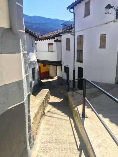 Architecture Built Structure Building Exterior Sunlight Building Shadow Nature Day Residential District No People House Outdoors Window City Entrance Direction The Way Forward Wall - Building Feature Wall Sky Alley