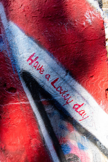 Close-up of text on red wall