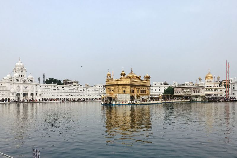 Golden Temple India Travel Photography Amritsar Architecture Belief Building Building Exterior Built Structure City Dome Gold Colored Outdoors Place Of Worship Reflection Religion Sikkim Sky Spirituality Temple Tourism Travel Travel Destinations Water Waterfront